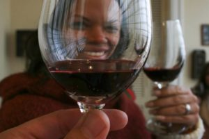 raising a glass of wine in a toast