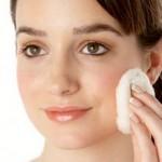woman applying facial toner