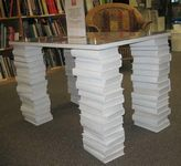 table on legs made from stacked books