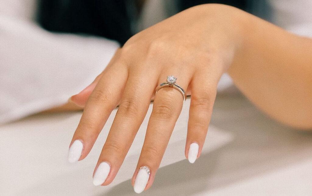 beautiful white polished fingernails