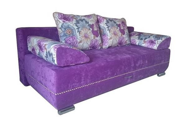 floral pillows on mauve sofa