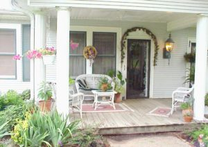 porch and entry with flowers and greenery