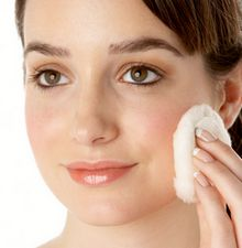 woman applying facial toner