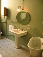 muted sage green bathroom